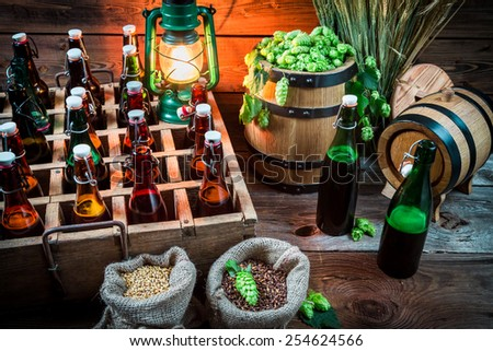 Ingredients for beer and bottles in the cellar - stock photo