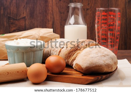 Ingredients for bread preparation on a wooden background
