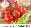 Ingredients for breakfast: tomatoes, eggs, sausage, garlic, peanuts, apples and lettuce. - stock photo