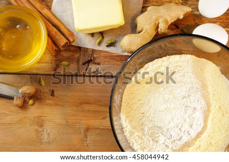 Ingredients for cookies (flour, eggs, spices, honey, butter).. Overhead view