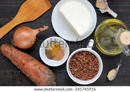 Ingredients for cooking buckwheat with cheese and carrot. - stock photo
