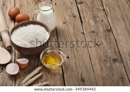 Ingredients for cooking flour products or dough. Flour, egg, milk close up.  Top view. Copy space - stock photo