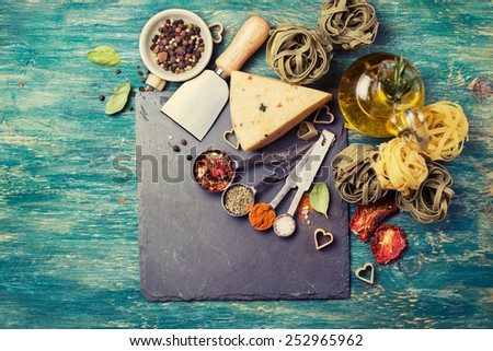 Ingredients for cooking Italian pasta, spices, cheese, olive oil - stock photo
