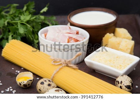 ingredients for cooking Italian style dishes spaghetti Carbon ara. spaghetti, bacon, cheese, quail eggs, spices. top view - stock photo