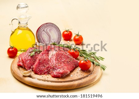 Ingredients for cooking meat with tomato, spices and rosemary - stock photo