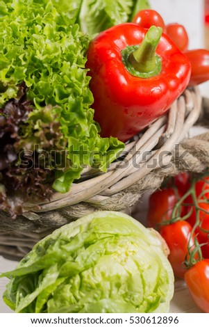 Ingredients for fresh spring healthy green salad-  green and red fresh lettuce salad leaves, paprika, tomatoes  - healthy low calorie food
