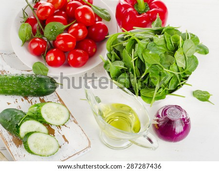Ingredients for Fresh vegetable salad on a white table - stock photo