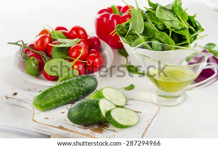 Ingredients for Fresh vegetable salad on  white wooden table - stock photo
