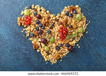 Ingredients for healthy cereal breakfast in shape of heart, food above