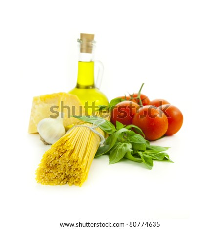 Ingredients for Italian cooking: basil, tomato, parmesan, garlic and spaghetti /  isolated on white - stock photo