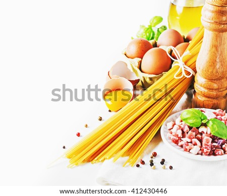 Ingredients for italian pasta alla carbonara  with parmesan and yolk on white. selective focus. - stock photo