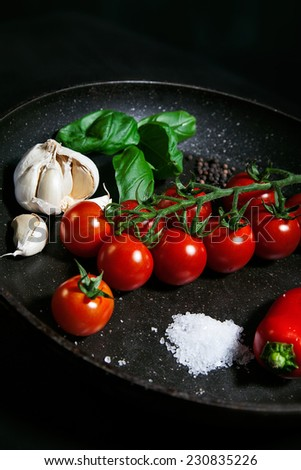 Ingredients for italian souse on frying pan side view - stock photo