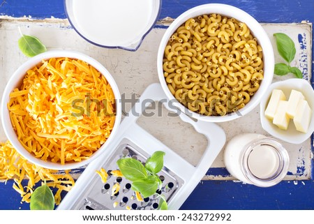 Ingredients for macaroni and cheese on the table - stock photo