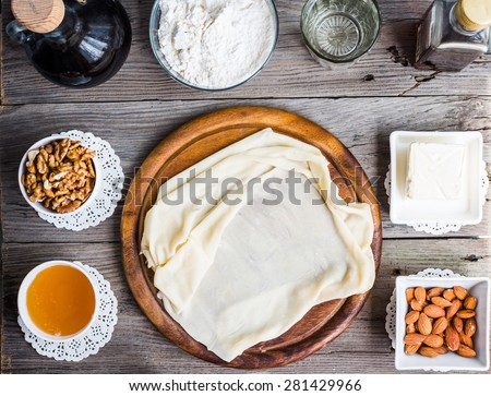 Ingredients for making homemade baklava,phyllo dough, nuts, honey, butter, top view, traditional Turkish dessert - stock photo