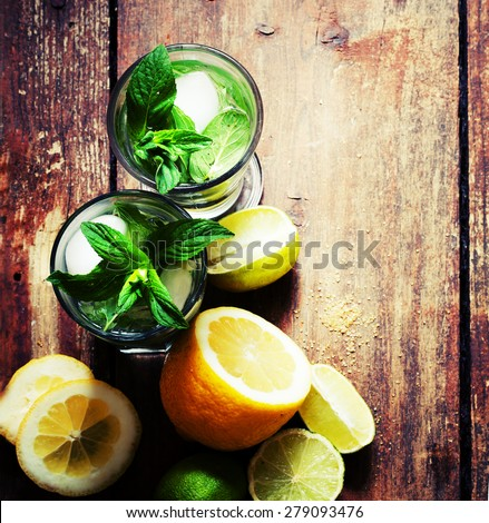 Ingredients for making mojito, selective focus/ Ingredients for mojito (fresh mint, limes, ice, sugar) / Top view. - stock photo