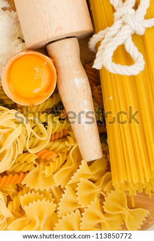 Ingredients for making pasta - flour and eggs on wooden table - stock photo
