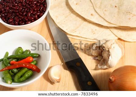 Ingredients for making tex-mex food, such as burritos, enchiladas etc - stock photo