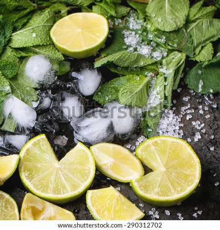 Ingredients for mojito (fresh mint, limes, ice, sugar) over black in retro filter effect. Square image - stock photo