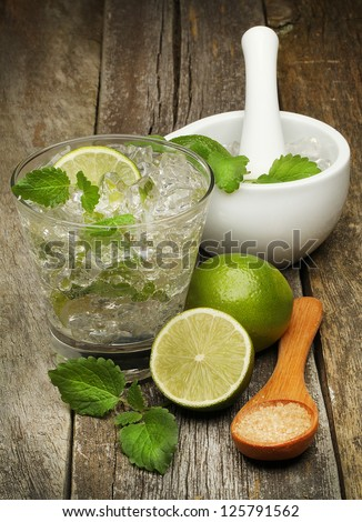 Ingredients for Mojito. Mortar,Pestle and Lime. Brown sugar - stock photo