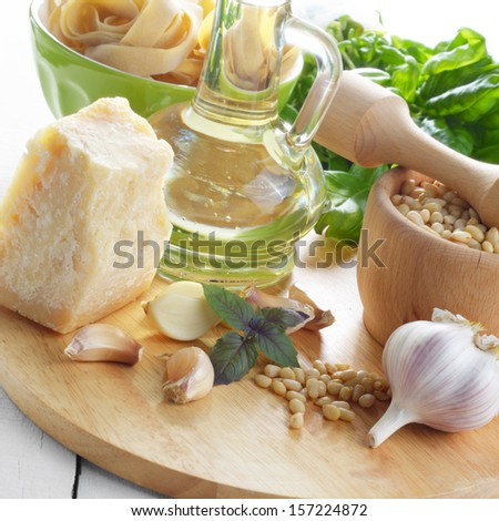 Ingredients for pasta pesto on white table