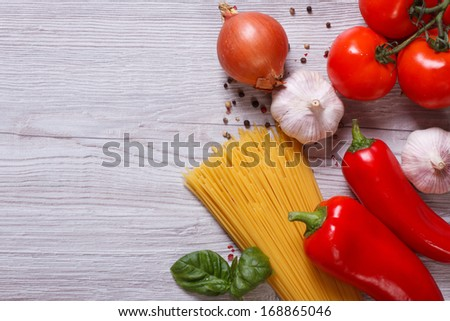 Ingredients for pasta: spaghetti, vegetables and spices on the table. top view - stock photo
