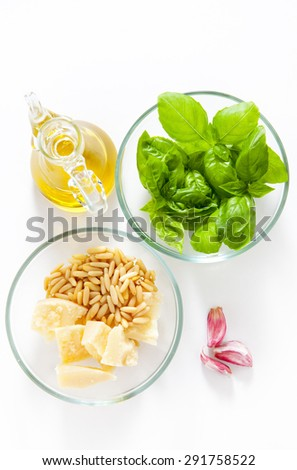 ingredients for pesto: parmesan cheese, basil leaves, pine nuts, olive oil. Italian healthy pasta sauce.