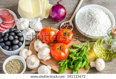 Ingredients for pizza on the wooden background - stock photo