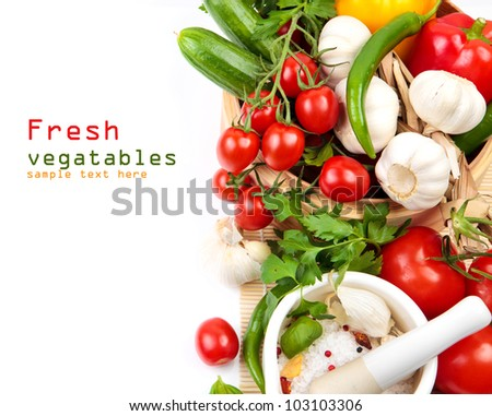 Ingredients for salad, fresh vegetables - cherry tomatoes, cucumbers, garlic and herbs on a white background with copy space