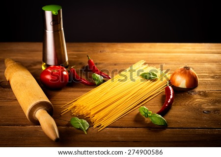 ingredients for spaghetti on a wooden table - stock photo