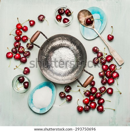 Ingredients for sweet cherry preserve,  jam or  jelly making, around empty cooking pot, top view, copy space. - stock photo