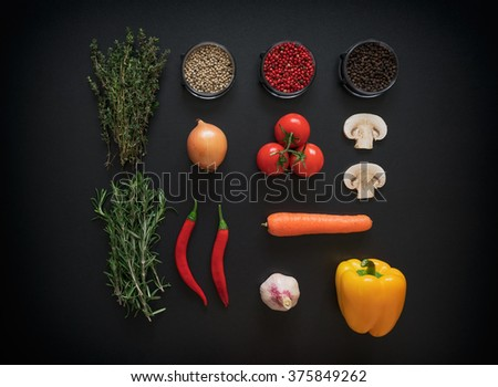 Ingredients for tasty salad making: lettuce leaves,champignons, tomatoes, herbs and spices on dark rustic background, top view, border. Healthy - stock photo