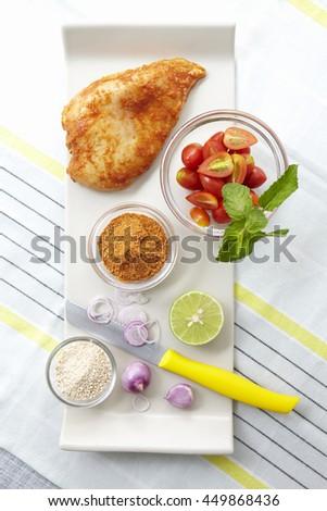 Ingredients for thai style spicy chicken steak - stock photo