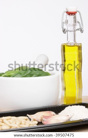 "Ingredients for the authentic italian ""pesto alla genovese"" sauce: basil, garlic, pine nut, extra-virgin olive oil, parmigiano reggiano, pecorino cheese and, obviously, a marble mortar and pestle."
