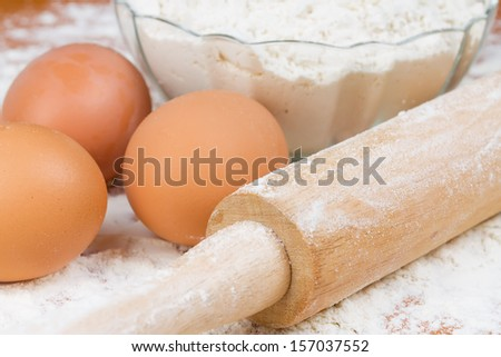 Ingredients for the dough - flour and eggs. - stock photo