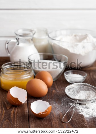 Ingredients for the pancake on the wooden table - stock photo