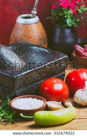Ingredients for traditional latin american tomato sauce prepared in stone