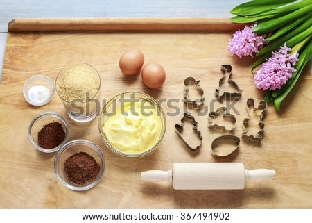 Ingredients necessary to make gingerbread pastry. Preparing easter gingerbread cookies. Steps of making pastry. - stock photo