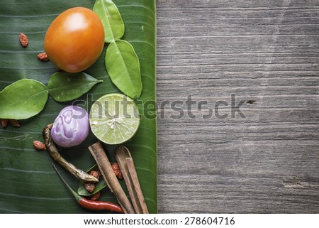 Ingredients of Thai spicy food, tom yum on wood background - stock photo