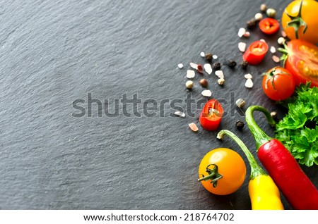 ingredients on black slate sample text selective focus - stock photo