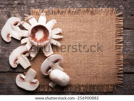 Ingredients with fresh mushrooms on burlap  background - stock photo
