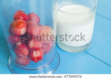 Ingridient for strawberry milkshake - strawberries in glass, milk