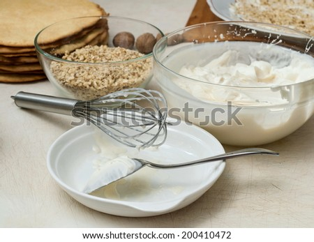 Ingridients for preparing sweet cake with nuts and cream - stock photo