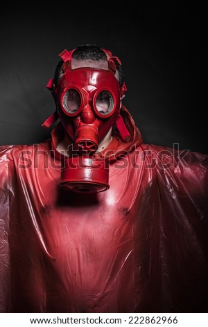 inhalation nuclear concept, man with red gas mask - stock photo