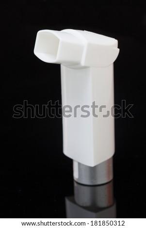 inhaler isolated on black - stock photo
