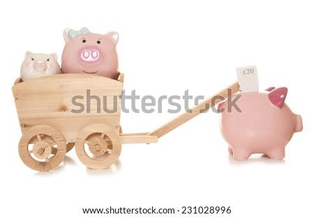 inheritance tax piggybanks studio cutout - stock photo