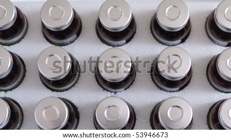 Injection bottles in polystyrene packaging - stock photo