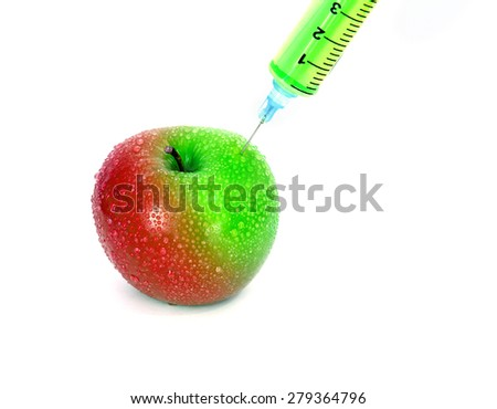 injection green into red fresh wet apple with syringe on white background for renew energy , therapy or refresh  or boost up energy concept