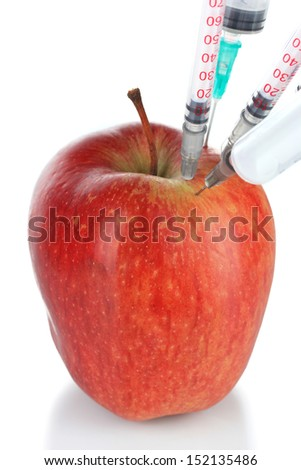 Injection into fresh red apple isolated on white - stock photo