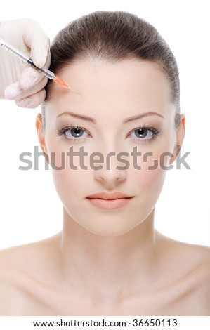 injection to a female's forehead - female portrait - stock photo