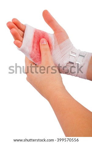 Injured hand of the girl tied up by white bandage